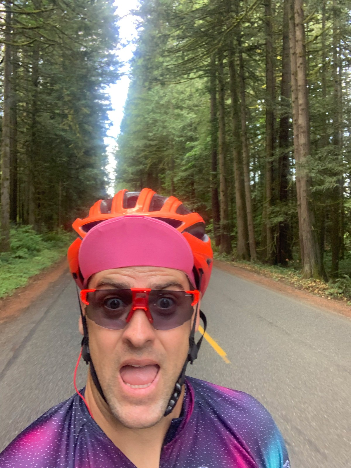 Rob takes a selfie with tree-lined road behind him.